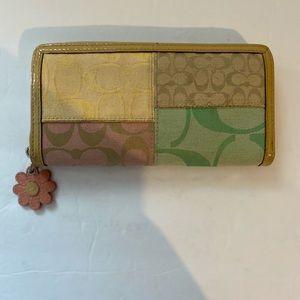 Coach Daisy clutch wallet multi colors pattern.